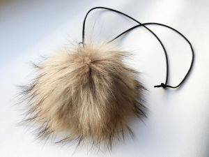 Necklace with raccoon pompom