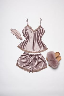 Set of pyjamas, slippers and sleeping mask eyes bandage in brown