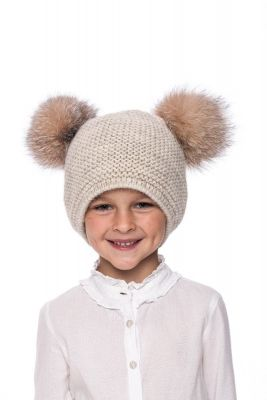 Baby size knitted beige wool hat with pompoms raccoon